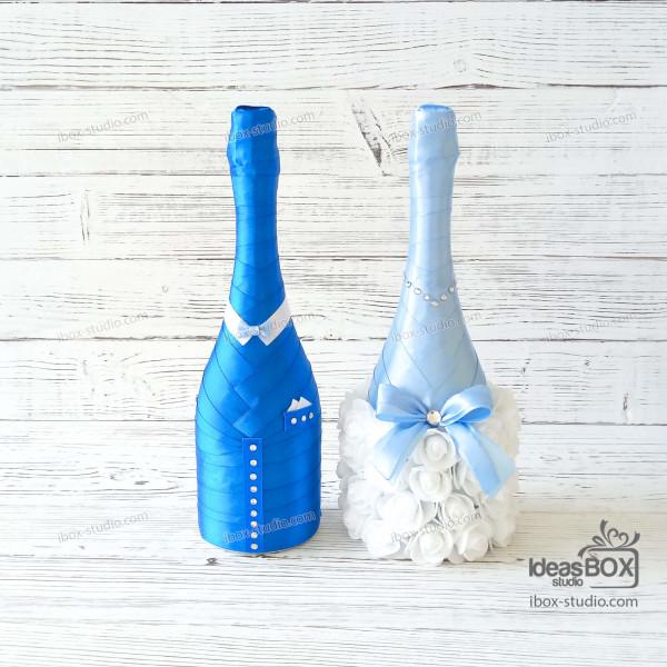 Весільні бокали, шампанське та свічки